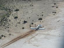 Aerial view of the plane landed on a salt lake