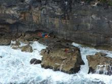 Image of debris and lifejackets mark the location on rocks at Christmas Island