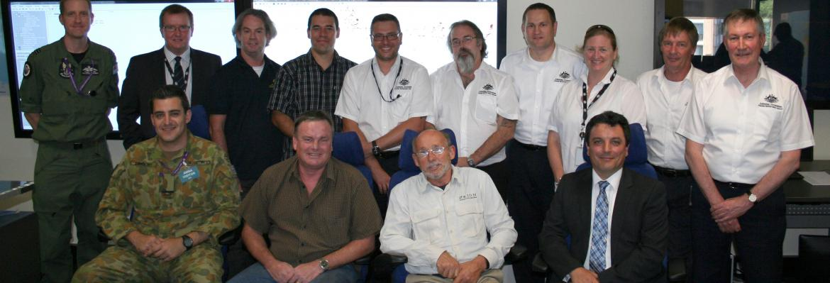 Rescued sailor Alain DeLord (front row, second from right) meets with AMSA search and rescue officers and Defence personnel who assisted in his rescue. Also present was David Steck, Deputy Consul, Embassy of France (front row, far right)
