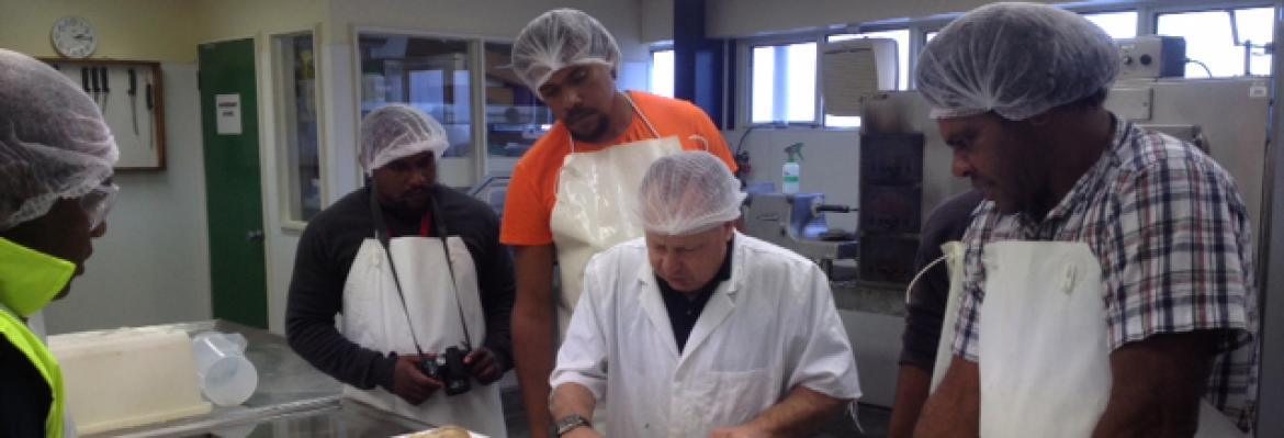 Students receiving instruction in handling and packaging seafood products