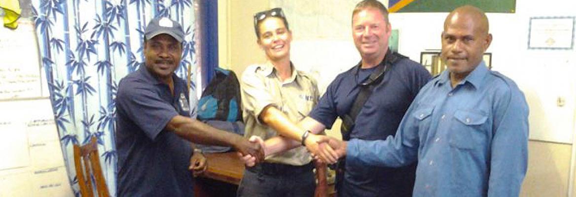 L-R): Peter Young, MRCC Honiara; Australian Government workers Maria and Stuart; and Enest Legumana, MRCC Honiara