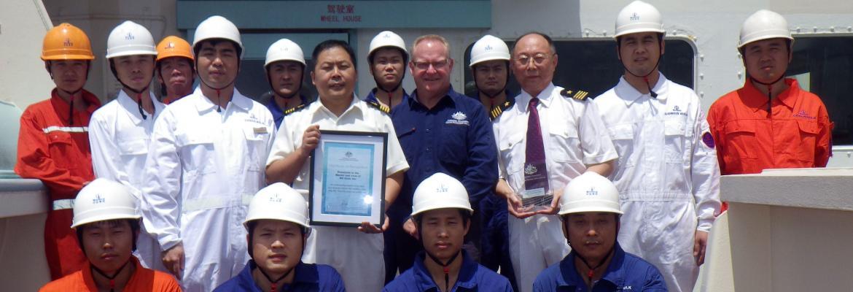 The Captain and crew of MV Xinfa Hai with AMSA Surveyor Greg Collinson, Newcastle