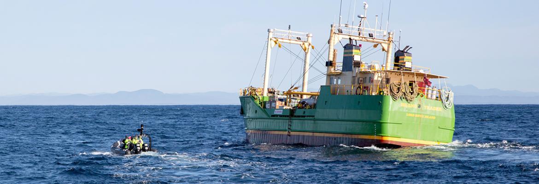 RHIB approaching MV Island Trader