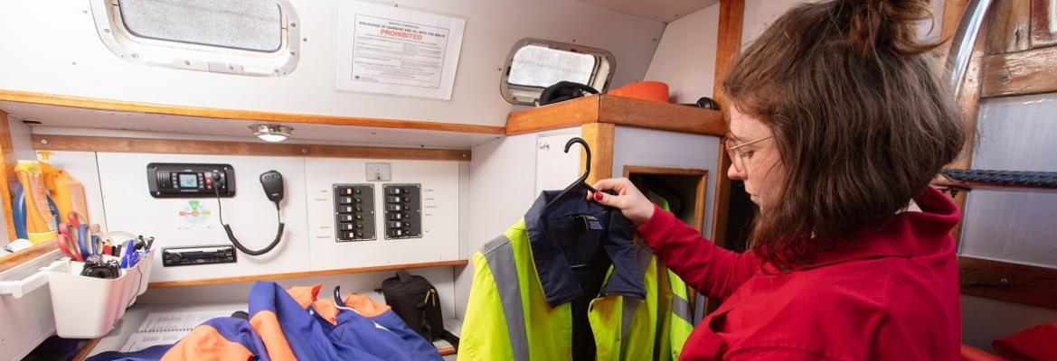woman holding hi-vis jacket