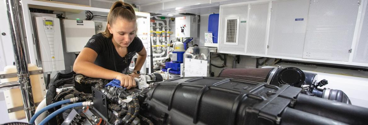 woman looking at an engine