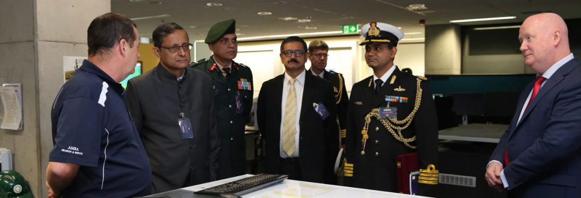 Our Chief Operating Officer, the Indian Secretary of defence and other members standing around a navigation table