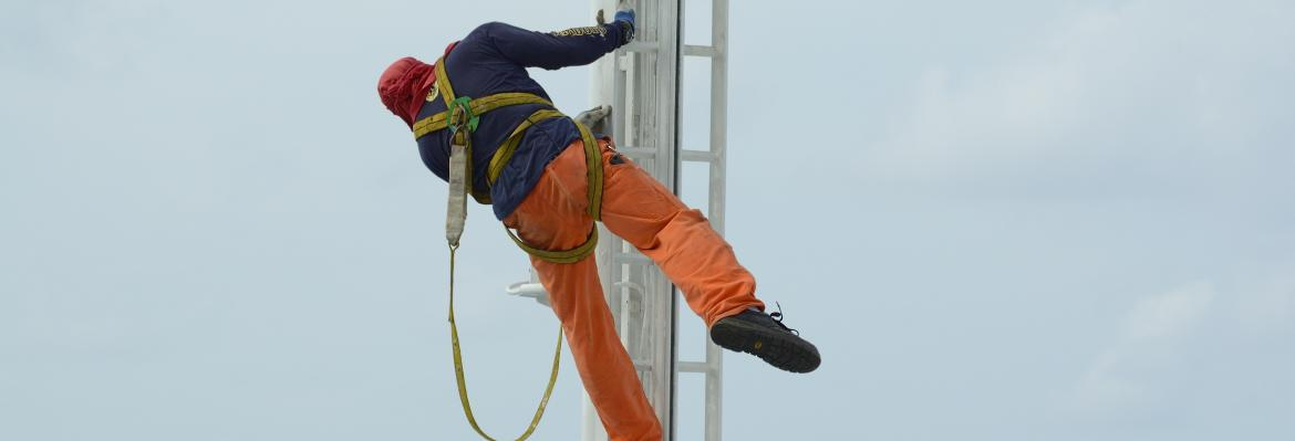 man working on a mast