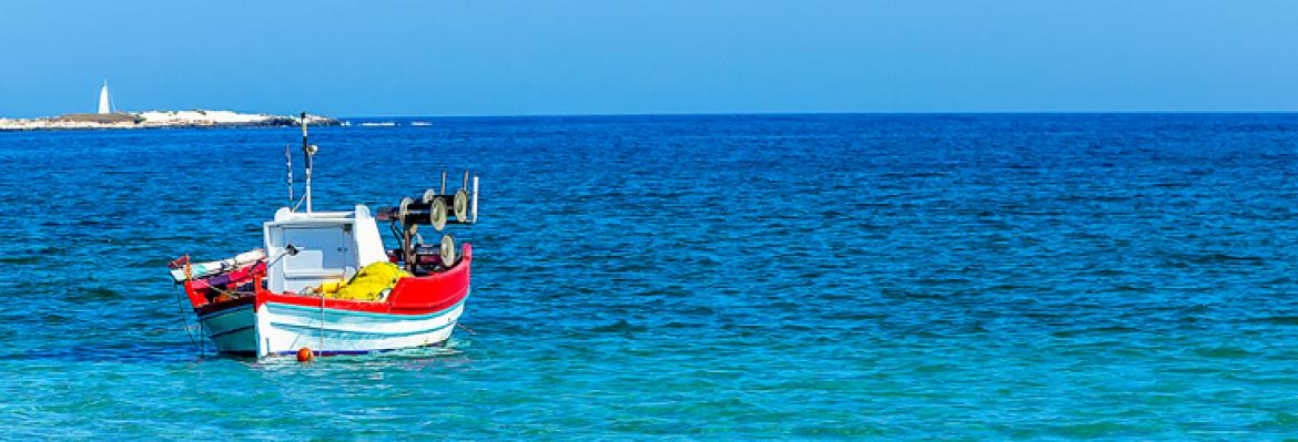 wooden boat in a clear blue sea