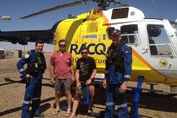 Image of the rescued motorcyclists with the crew of the rescue helicopter