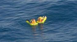 Image of survivors in the water after ultra-light aircraft engine failure