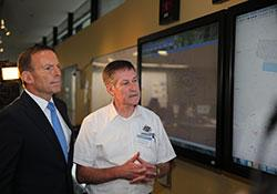 Image of RCC Australia Chief Lynn Walton providing the Prime Minister with an overview of the search operation