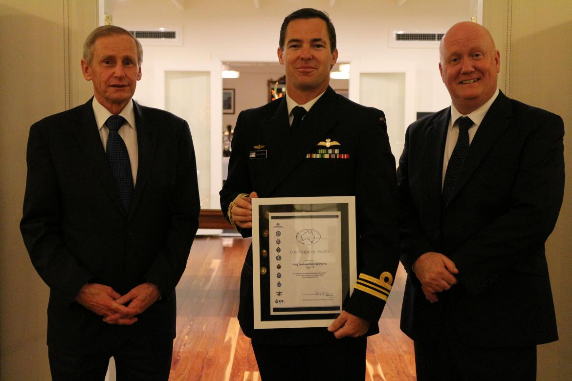 Lieutenant Commander David O'Toole (middle) accepted the Commendation Award on behalf of the crew of the Navy Seahawk helicopter Tiger 74. Pictured with National Search and Rescue Council Chairman John Young (left) and AMSA Chief Executive Officer Mick Ki