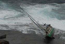 Image of yacht Vector grounded on rocks