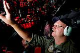 Royal Australian Air Force (RAAF) Flight Engineer Warrant Officer Neil Scott-Jackson onboard an AP-3C Orion on route to RAAF Base Pearce Western Australia after searching the southern Indian Ocean as part of the Australian Maritime Safety Authority-led search for Malaysia Airlines flight MH370.