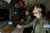 Royal Australian Air Force (RAAF) Sergeant Chris Platt operates the electro-optic station onboard an AP-3C Orion over the southern Indian Ocean as part of the Australian Maritime Safety Authority-led search for Malaysia Airlines flight MH370.