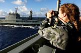 Lieutenant Raina Taggart uses the range finder binoculars to gauge the distance to HMAS Success from the starboard bridge wing of HMAS Toowoomba during preparations for a Replenishment at Sea during Operation SOUTHERN INDIAN OCEAN.