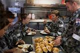 Crew of HMAS SUCCESS enjoy freshly made hot cross buns as HMAS SUCCESS spends the Easter period at sea on Operation SOUTHERN INDIAN OCEAN.