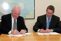 The Australian Maritime Safety Authority's previous Chief Executive Officer, Graham Peachey and the Australian Antarctic Division's Director, My Tony Press, signing the memorandum of understanding