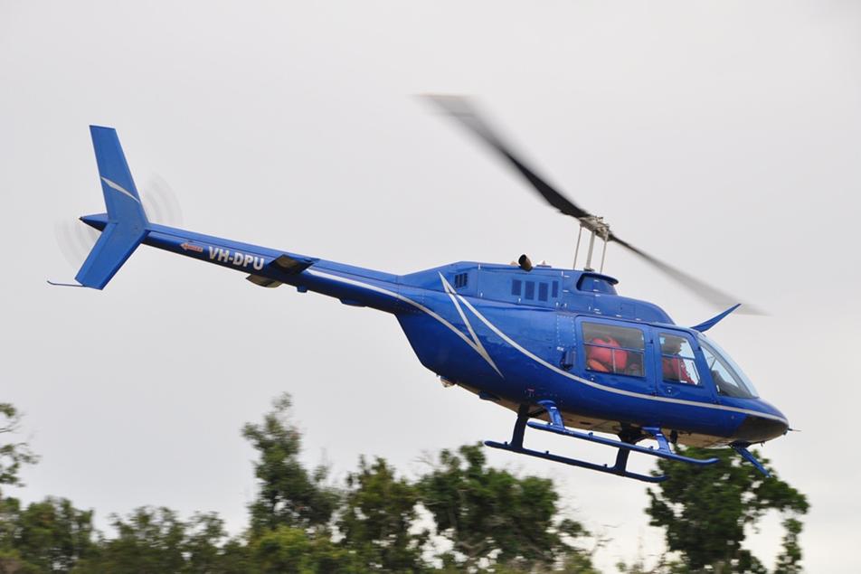 Bell Jest ranger helicopter falling over trees