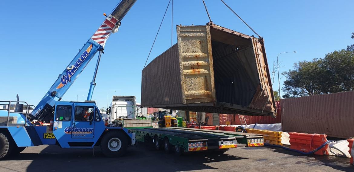 Container lifted in waste yard