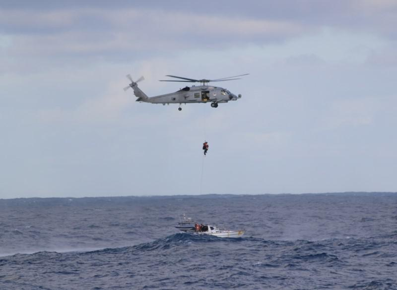 helicopter winching passengers from the Jedi boat