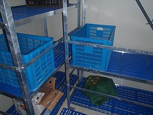 Shelves in the kitchen of a ship are bare and boxes of food are empty